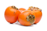 Persimmon fruits on white