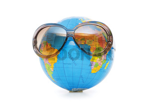 Globe with sunglasses isolated on the white