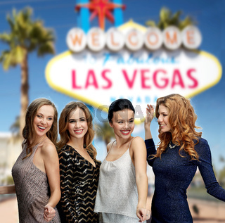 group of happy women or friends at las vegas party