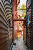 Narrow passage between historic wooden buildings in Bryggen