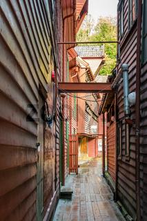 Narrow passage between historic wooden buildings in Bryggen