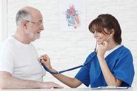 Doctor examining heartbeat of senior Man