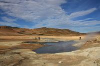 Pond with boiling mud. Geothermal area near Reykjahlid, Iceland.