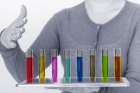 Person with test tubes