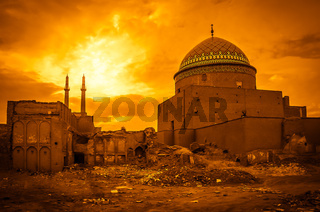 Sunset over the damaged mosque in Kashan in Iran