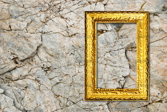 Gold frame on a stone background