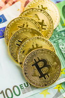 Golden bitcoins. Cryptocurrency and euro currency.