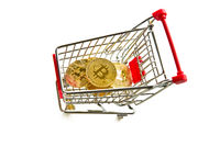 Golden bitcoins. Cryptocurrency and shopping cart.