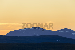 Mountain silhouettes at sunset