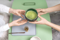 Holding bowl with green matcha tea