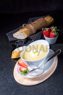 asparagus soup with poached egg and fresh baguettes