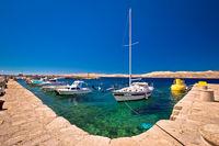 Floating boat on turquoise sea in Velebit channel