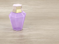 Perfume on wooden table