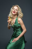 beautiful girl in long dress with champagne