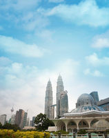 Daytime view of famous Asy-Syakirin Mosque with Petronas Towers