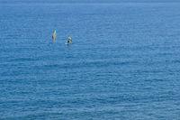 two windsurfer far away on ocean, aerial