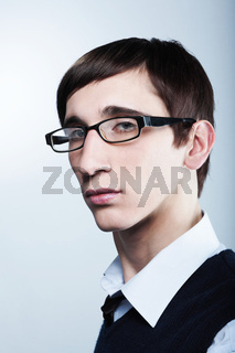 Cute young guy with fashion haircut wearing glasses