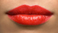 lips or mouth of woman with red lipstick