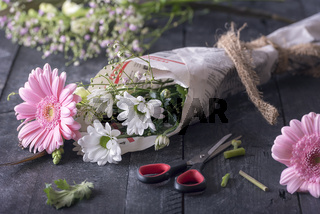 Flowers wrapped in newspaper