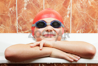 Funny boy in swimming eyeglasses and cap