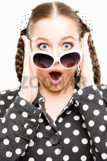 young woman in retro outfit looking very surprised