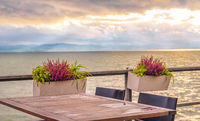Outdoor table on lake shore