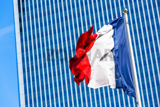 French flag with business building on background. Trubulence Concept