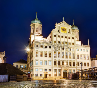 Illuminated town hall of Augsburg at night