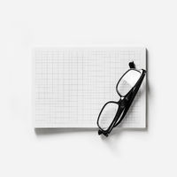 Copybook and glasses