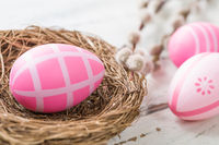 An easter nest with pink easter eggs