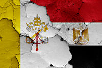 flag of Vatican and Egypt painted on cracked wall