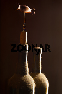 Wine bottles and corkscrew