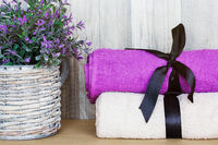 Towels with a decorative plant. Beauty Spa Health and Wellness concept.