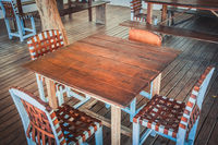 wooden table and four chairs - empty restaurant