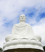 Statue of the Buddha against the blue sky