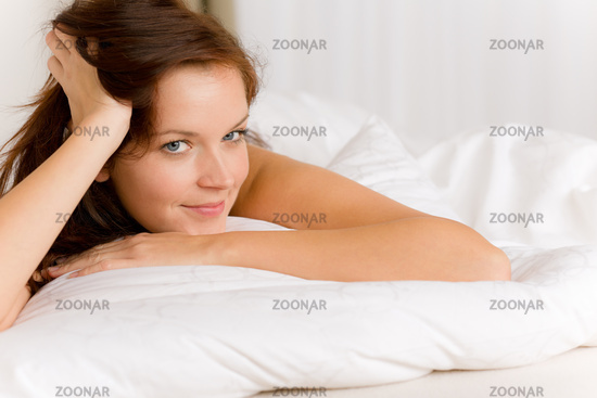 Bedroom - happy woman in white bed