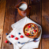 rustic muesli breakfast with forest fruits
