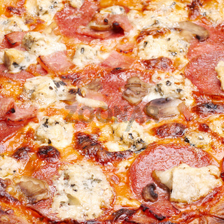Pizza with cheese, salami and mushrooms