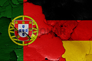 flags of Portugal and Germany painted on cracked wall