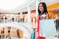 Beautiful young woman with shopping bags at the mall
