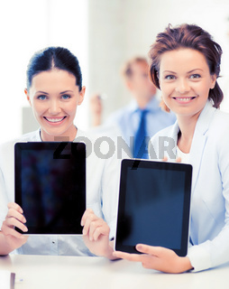 business team showing tablet pcs in office