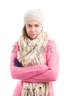 Young woman wearing knitted warm clothes with arms crossed