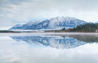 mountain range reflected in Barmsee lake