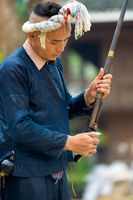 Biasha Miao Minority Man Gun Rifle Bun Hairstyle