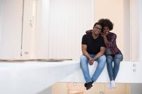 couple having break during moving to new house