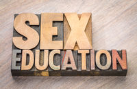 sex education word abstract in wood type