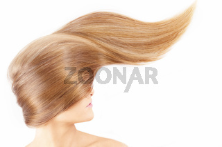 Smooth surface of a fair hair on a white background
