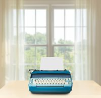 Electric typewriter in front of bright window