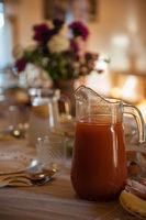 Decorated table with jug of juice