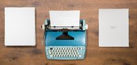 Old electric typewriter on used by author for book